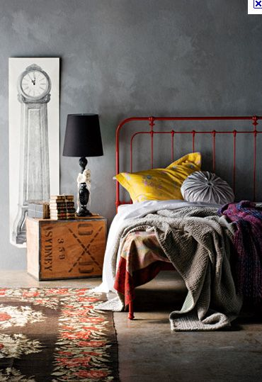 Industrial vintage. Love the use of the old box for the nightstand. And who doesn't love concrete floors. I could see this in any number of lofts in Deep Ellum.