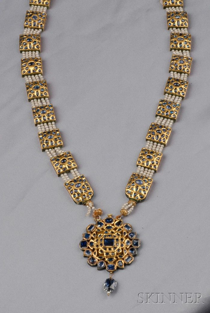 Antique High-Karat Gold, Foil-back Sapphire, Enamel, and Seed Pearl Pendant Necklace, the rectangular links set with cabochon sapphires, reverse with polychrome enamel, joined by strands of seed pearls, suspending a pendant set with mixed-cut sapphires and a briolette, completed by silk tassels, lg. 22 and 3 in. Indian or Indian style