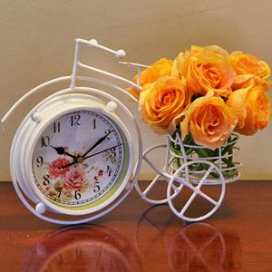 Beautiful table clock and flower bunch combo for Mom  Rs 1449/- http://www.tajonline.com/mothers-day-gifts/product/md2062/an-amusing-clock-combo/?aff=pint2014/