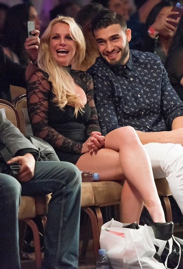 Britney Spears and boyfriend Sam Asghari attended a Los Angeles Fashion Week show on Thursday, March 16, to cheer on his sister, Faye Asghari.