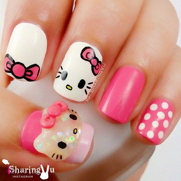 Light up your nails with this pretty in pink Hello Kitty nail ensemble! Matted in white and pink, special Hello Kitty details are added such as Hello Kitty's pink bows and cute face. White polka dots are also painted to divert from the plain colors of the other nails.