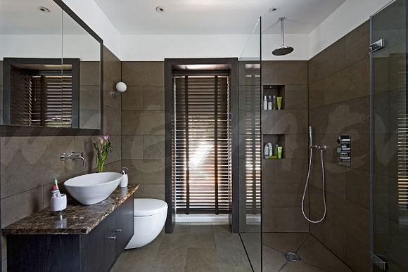 Image: Porcelain wall tiles in modern brown bathroom with slatted ...