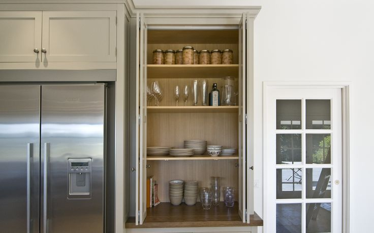 Handy concealed pantry / appliance cabinet revealed with open bi fold doors.  A wonderful way to keep the kitchen looking clutter free.