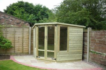 Tanalised Corner Summerhouse.  Dream shed for me at the bottom of the garden.  But more rectangular.