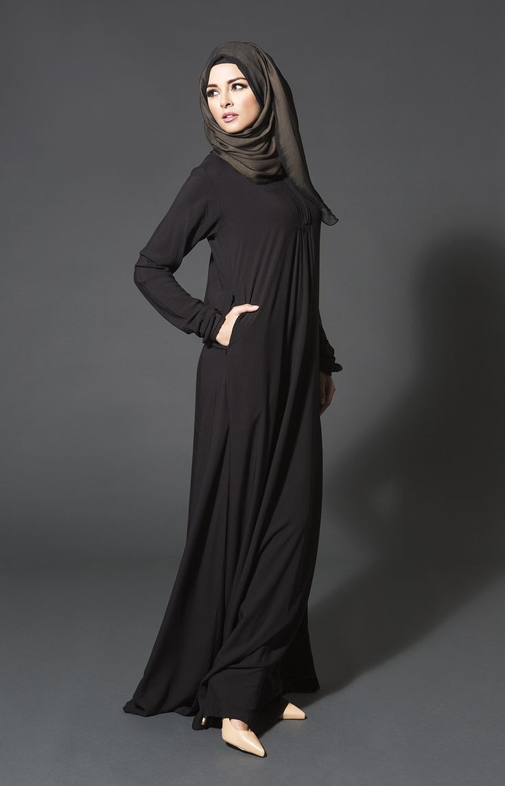 BLACK SEA is the perfect piece for Hajj and Umrah. Simple classic black with pretty but discreet pleating, this is your ideal Abaya for worship and general styling.