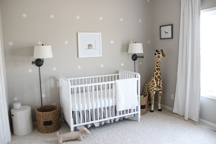 Gender Neutral Gray Zoo Themed Nursery - Neutral walls, white Jenny Lind crib and Pom trim curtains