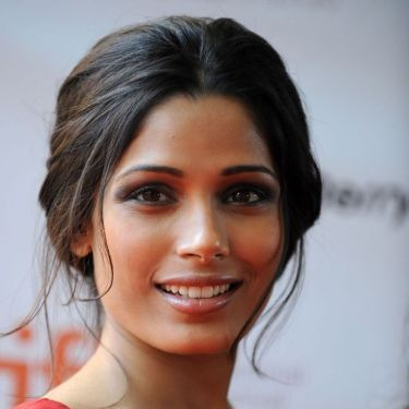 Freida Pinto shows off the romantic look she loves with this low and loose chignon.
