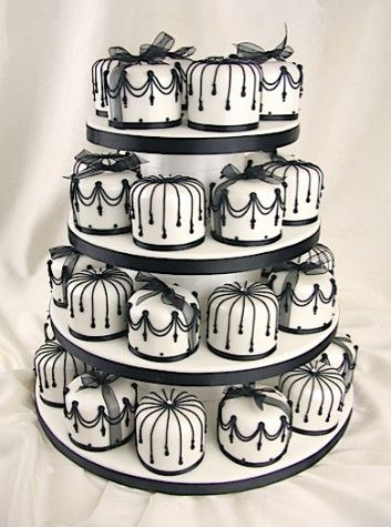 Fabulous black and white wedding cupcakes - I don't even know how to make those! With a cookie cutter, maybe?