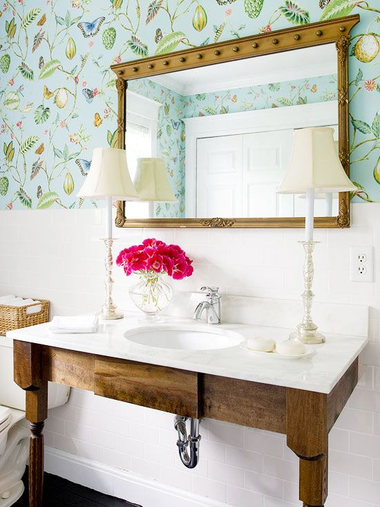 natural vanity paired with the graphic wallpaper and white accents