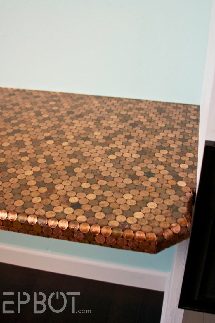 Computer table covered in pennies