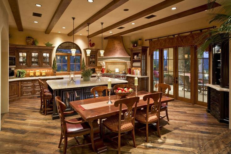 Mediterranean kitchen with wood flooring granite counters and raised wood cabinets