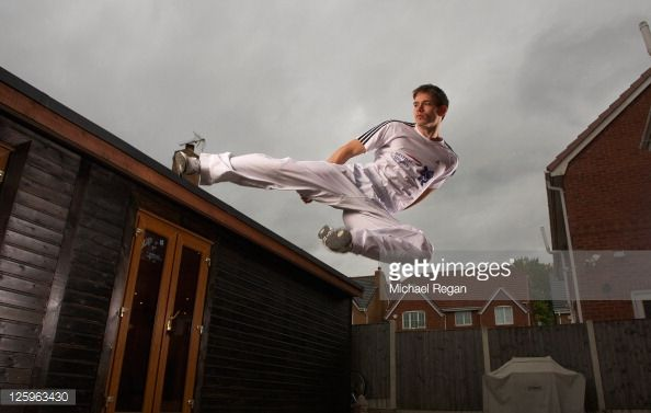 Olympic Taekwondo hopeful Aaron Cook of Great Britain poses for pictures during a British Airways photo feature at the specially constructed gym in...