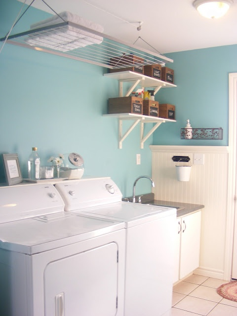 I like the narrow shelf over the washer/dryer and the bigger shelves higher up.  I wish I could use one of those drying racks but the ceiling isn't high enough in our home.  White trim really helps keep the room brighter.