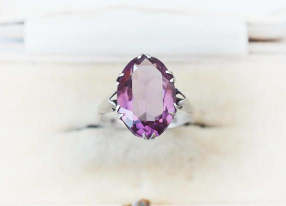This is a boho style Art Deco amethyst (or look-alike) sterling silver ring. Might be from the 1910s, or later. Signed for sterling. Good unused condition with some patina. Mixes well with other rings, really lovely boho ring. Doubble claw setting, open back. 17 x 11 mm stone. RING SIZE: