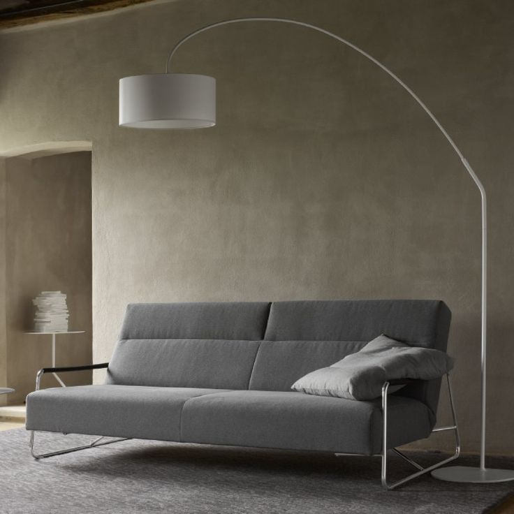 The contemporary Janus sofabed by Pascal Mourgue, 2011. As a Settee it has a movable headrest to give extra support and 5 possible back positions. As a bed, the seat come forward to create a generous 140cm sleep area and the armrest become head and foot rests.