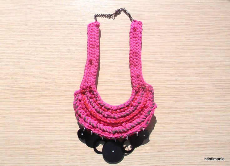 Crochet necklace made of upcycled t-shirts and other reused elements.