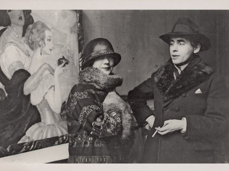 Courtesy The Royal Library Gerda Wegener and her husband, Einar, who would become Lili Elbe, in front of one of Gerda's paintings depicting herself and Lili.