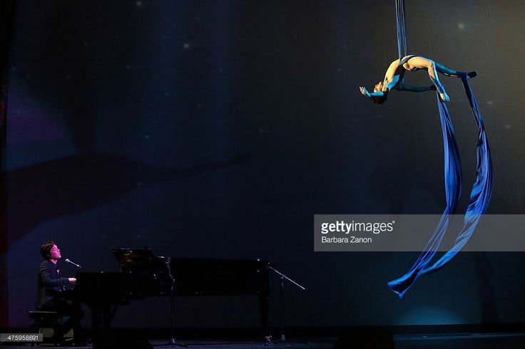 """Nico Gattullo performs aerial silks act on """"Hallelujah"""" sung and played on piano by Rufus Wainwright during Cavalchina at Teatro La Fenice in Venice. Photo: Barbara Zanon"""