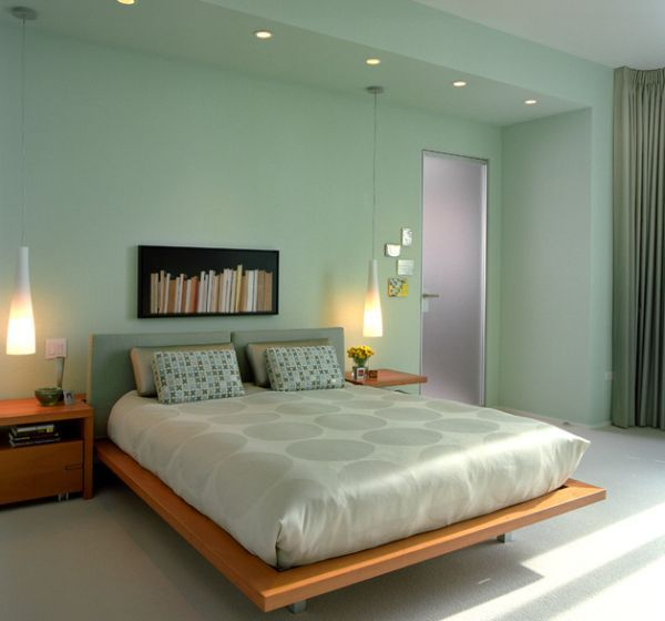 Sleek pendants fit in with the contemporary theme of the bedroom