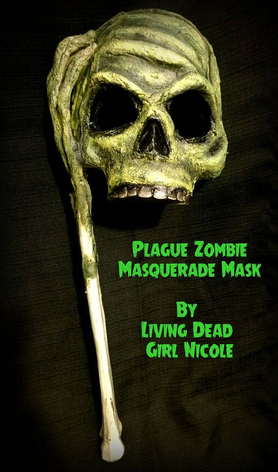 This listing is for a Zombified Plague Masquerade Mask! Complete with arm bone for the stick! For more photos of my zombie creations visit my site at: http://www.artworkbylivingdeadgirlnicole.com/#!braaains/c17nn