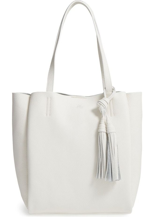 A knotted tassel charm adds flirty movement with every step on this roomy pebbled-leather tote topped with easy over-the-shoulder handles.