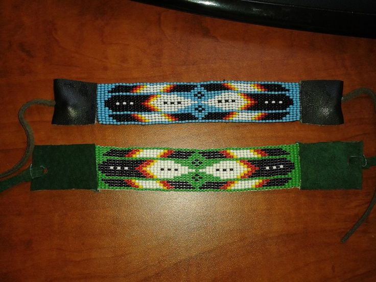 Twin Feather cuff bracelets made by Jonathan @ Robins Cree-Creations on facebook