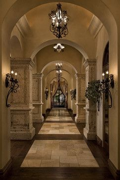 Beautiful Mediterranean Hallways - Fratantoni Luxury Estates; Note the flooring design. This will be some of the unique features in the 7000 sq. ft. remodel. Insight to the 90 ft. hallway design with eyebrows not full arches. Love the lighting and sconces. Ray take note how the columns appear on the right side of the hall. This is how it has to be done. Love it~