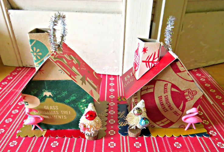 Holiday Welcome!Here is a fun pair of Christmas ornaments made with vintage and new materials!These whimsical ornaments are made from vintage Christmas ornament boxes! A decorated bottle br...