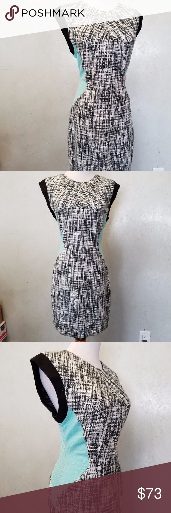 Sheike houndstooth and teal dress In perfect condition like new houndstooth dress with an extension in the skirt ... with mint color sides Sheike Dresses Midi