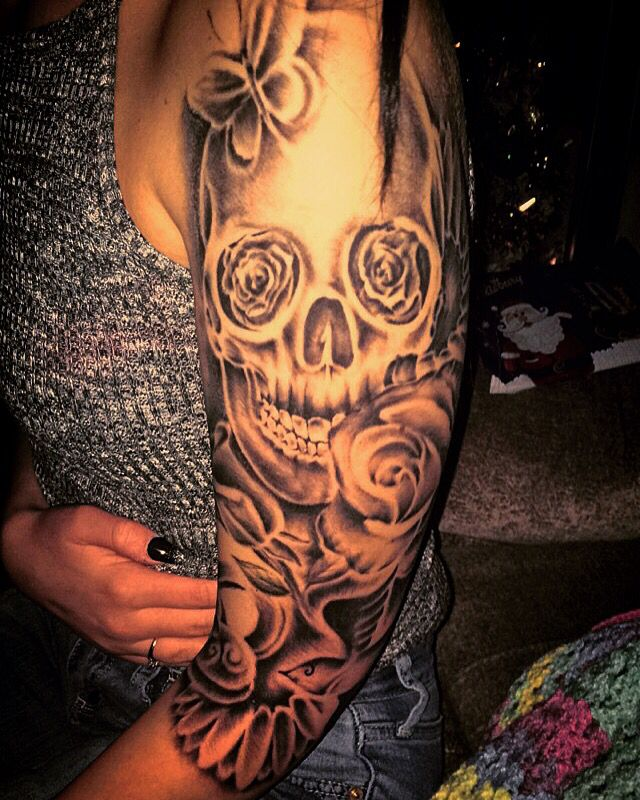 Girls half sleeve tattoo skull swallow lock realistic rose and daises done by kurt stanley