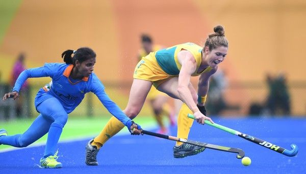 India's Vandana Katariya vies for the ball with Australia's Georgina Morgan during the women's field hockey India vs Australia match of the Rio 2016 Olympics Games at the Olympic Hockey Centre in Rio de Janeiro on August, 10 2016. / AFP / MANAN VATSYAYANA