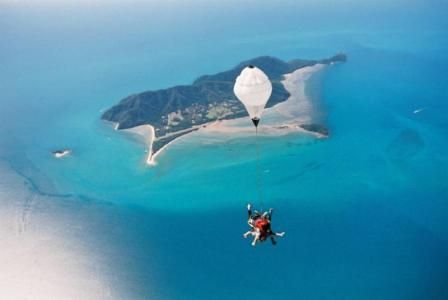 Skydiving over the rain forest and the Great Barrier Reef in Mission Beach, Australia.