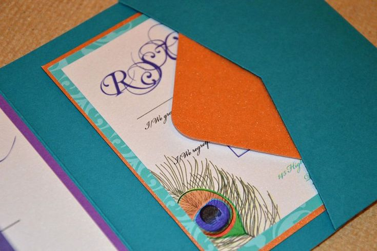 Peacock teal pocketfold envelope matched with purple backing card and topped with a crisp white insert. www.justaddyou.ie
