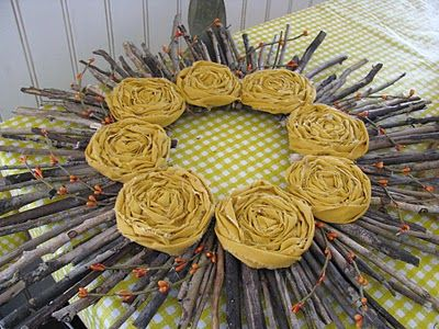 Project Idea: Sunshine Wreath made with twigs and yellow rosettes.  (Link to the rosette tutorial she used is on the page.  From Yellow Mum.