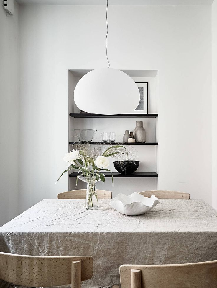 Dining area with a built in shelf - via Coco Lapine Design blog