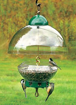 Squirrel proof bird feeder. This thing costs 80 bucks but I bet I could make it with a couple of cheap plastic bowls and a little hardware.