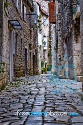 Narrow stone street of Trogir Croatia in Europe.