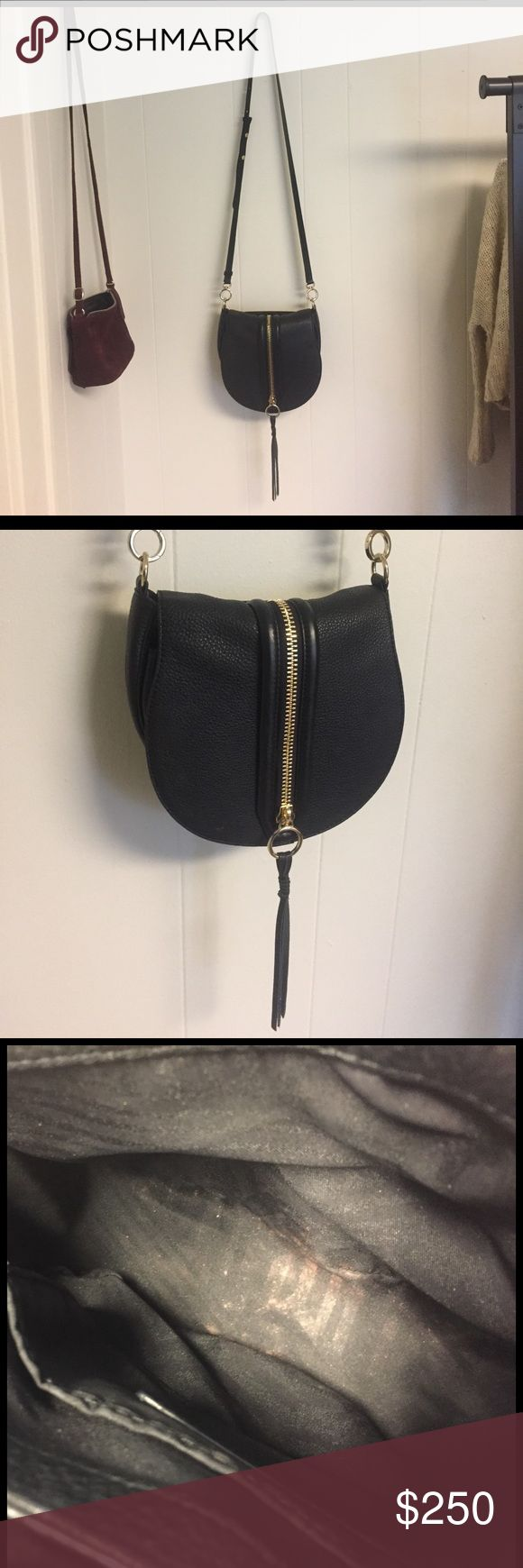 Rebecca minkoff cross body bag Gently used cross body. Has a few stains of make up on the inside but can be removed. The tassels were cut off to be shortened since they looked too long on me. Still beautiful bag. Bought it at Bloomingdales. Still have the tags. Rebecca Minkoff Bags Crossbody Bags
