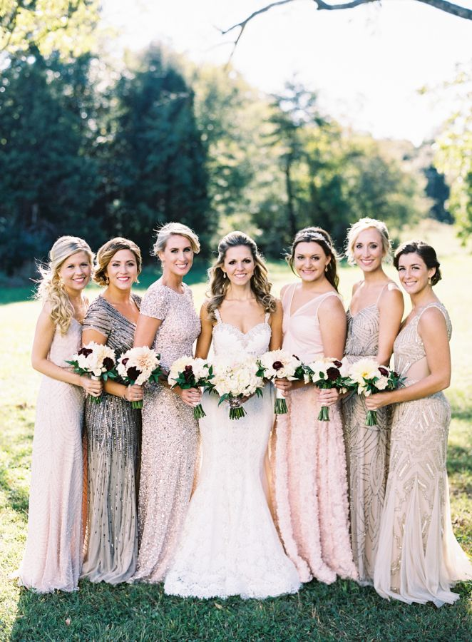Mix and match shimmery bridesmaid gowns: http://www.stylemepretty.com/north-carolina-weddings/raleigh/2016/05/05/she-said-yes-to-the-dress-i-do-to-a-glamorous-fall-wedding/ | Photography: Graham Terhune - http://grahamterhune.com/