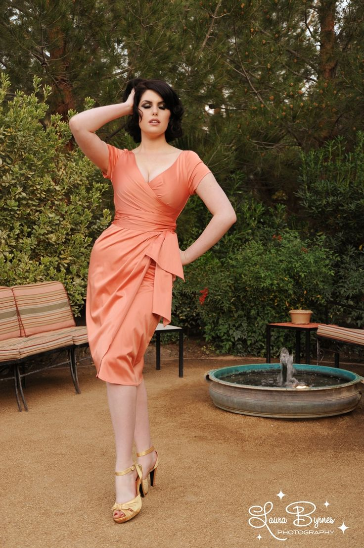 Ava Dress in Tangerine - The Ava Dress has now become one of our most popular Pinup Couture styles for everything from a night on the town to bridal parties.  Offered in an array of jewel tones and wedding colors, the Ava is made of a luxurious shakira satin and features a faux wrap front and tulip skirt, back zipper, attached wrap belt, and gorgeous plunging neckline. The result is a cut flattering on just about every body type and suitable for a variety of occasions.