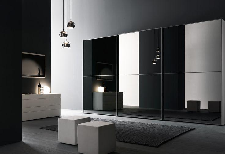PRESOTTO   #Wardrobe with L12 sliding doors with grey mirror panels and matt metallic grigio grafite lacquered frames.__ #Armadio con anta scorrevole L12, specchio grigio con profilo laccato opaco grigio grafite metallizzato.