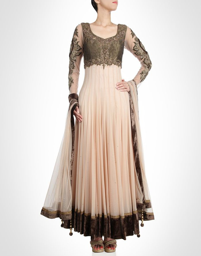 Soft cream net anarkali is enriched with floral embroidery appliqué all over the sheer sleeves. Shop Now: www.kimaya.in