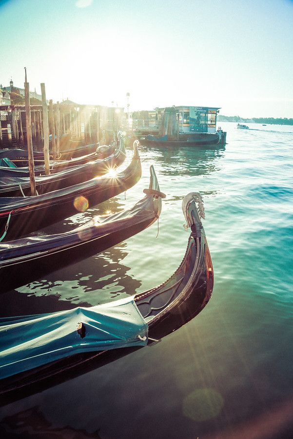 Naturally, there are gondolas all over Venice, but the best place to shoot them is around the edge of St. Mark's Square as the sun is setting. Almost all of the gondoliers bring their boats in here at the end of the day and dock them for the night. It's one of the best times to come see them all lined up in processing. - VENICE, ITALY - photo from #treyratcliff Trey Ratcliff at http://www.StuckInCustoms.com