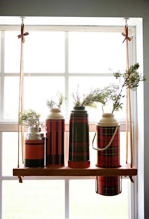 Non traditional window treatments (Thank you, FunkyJunk blog).  Old Thermos' on a swing.  Neat.