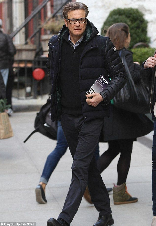 Still looking sharp: Colin Firth swapped his dapper attire for smart-casual wear in a stylish coat and a shirt and jumper combination in New York City on Tuesday