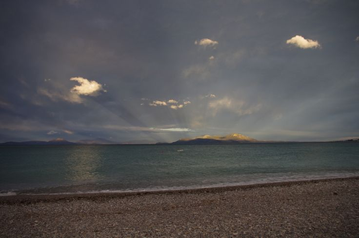 Sun rays converging at the Temple of Hera (Perachora), as seen from the beach of Sykia.
