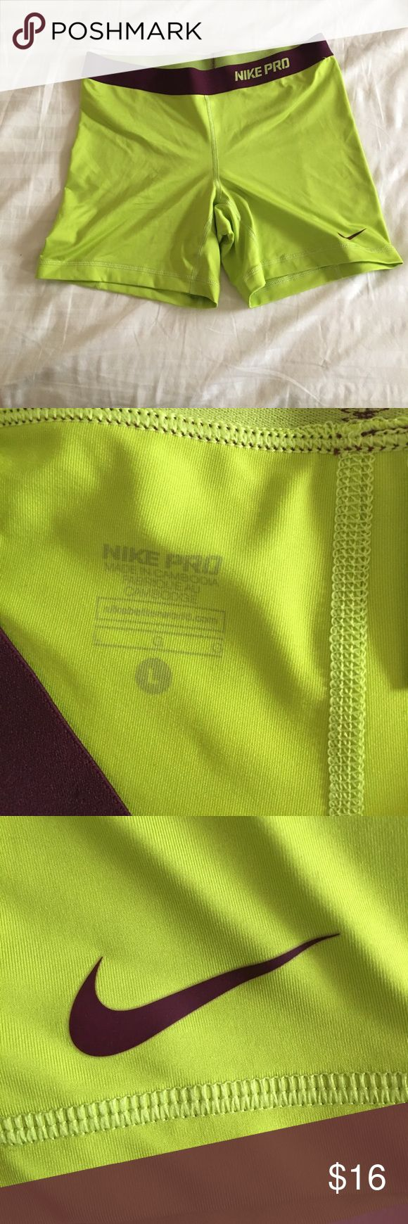 """Neon yellow 3"""" Nike Pros Lime green longer Nike pros. Dark purple band. Worn once. Great condition. Nike Shorts"""