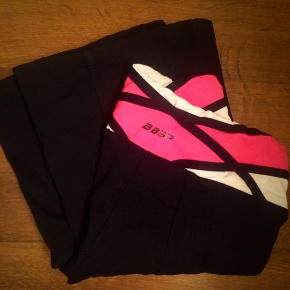 BEBE SPORT YOGA PANTS EXTRA SMALL sexy black pink BEBE SPORT YOGA PANTS EXTRA SMALL sexy black pink. Perfect condition. Look absolutely amazing on! New with out tags bebe Pants Track Pants & Joggers