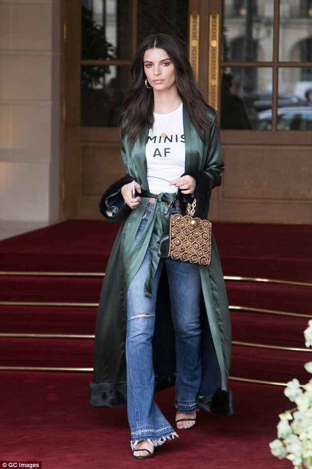 Trendsetter: Emily Ratajkowski, 25, dressed up her casual look with a green silk duster co...