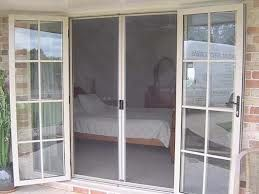 outward french doors with screens
